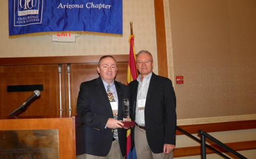Lamont Boyd receives Clay Hopkins Light the Way Award from AZ CPCU Chapter President Will Thomas